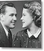 Young Couple Looking In Eyes In Studio Metal Print