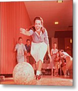 Young Woman Bowling, Family Watching In Metal Print