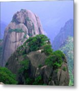 A Rocky Outcropping Overlooks A Mist-covered China Mountain Range Metal Print