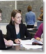 Caucasian students and teacher talking in classroom Metal Print