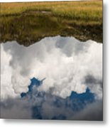 Clouds and mountains reflecting in mountain lake Metal Print