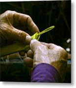 Hands form a palm leaf into a small work of art Metal Print