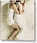 Man and woman cuddling in bed Metal Print