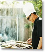 Smiling father grilling in backyard during family barbecue Metal Print