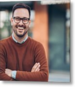 Smiling man outdoors in the city Metal Print