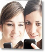 Teenage girls using cell phones Metal Print