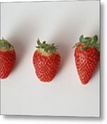 Three strawberries in a row, close-up, white background Metal Print