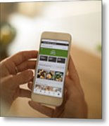Woman using meal delivery service through mobile app. Metal Print