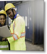 Young African american men and woman worker Check and control loading freight Containers by use computer laptop at commercial shipping dock felling happy. Cargo freight ship import export concept Metal Print