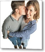 Young Couple With Brown Hair With The Boy Kissing The Girl On The Cheek And She Is Excited And Smiles Metal Print