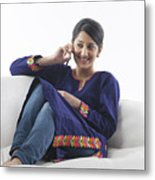 Young woman talking on her cell phone Metal Print