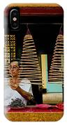 Man Lighting Incense In Chinese Temple Vietnam IPhone Case
