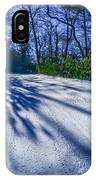 Snow Covered Road Leads Through The Wooded Forest IPhone Case