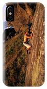 A Man Is Bouldering Near The Ocean IPhone Case