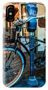 A Bike In Front Of Cafe Du Monde In New Orleans IPhone Case