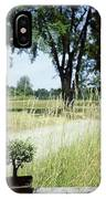 A Bonsai Tree In A Hayfield IPhone Case
