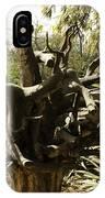 A Wooden Sculpture Inside A Garden IPhone Case