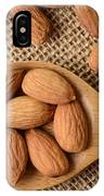 Almonds On A Spoon With Brown Background IPhone Case