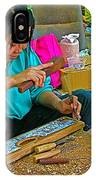 Child Watches As Mom Works In Teak Wood Carving Shop In Kanchanaburi-thailand IPhone Case