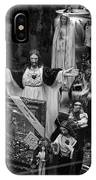 Jesus With Arms Wide Open Religious Figurines In A Shop Window In Toronto IPhone Case