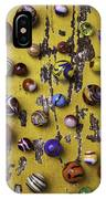 Marbles On Yellow Wooden Table IPhone Case