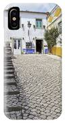 Medieval Cobblestone Street In The Fortified Walled European Village Of Obidos IPhone Case