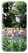 Oil Painting - A Number Of Flamingos Surrounded By Greenery In Their Enclosure  IPhone Case