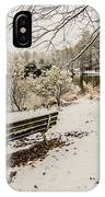 Park Bench In The Snow Covered Park Overlooking Lake IPhone Case