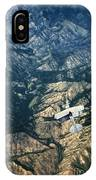 Small Plane Flying Over Mountains IPhone Case