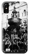 tourists and visitors sit on the steps of the eros statue in picadilly circus London England UK IPhone Case