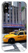 Yellow Cabs Pass In Front Of Radio City Music Hall IPhone Case