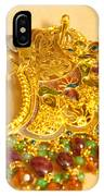 A Beautiful Intricately Carved Gold Pendant Hanging From A Semi-precious Stone Chain IPhone Case