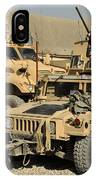 A M1114 Humvee Sits Parked In Front IPhone Case