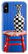 Blach And White Vase On Stool Against Blue Wall IPhone Case
