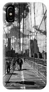 people walking over the brooklyn bridge between cables towards lower manhattan New York City USA IPhone Case