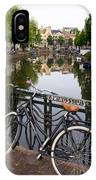 Bicycle Parked At The Bridge In Amsterdam. Netherlands. Europe IPhone Case