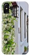 Colonial Home Exterior With Vertical Plants And Old Lanterns Displayed On The Side Of Home IPhone Case