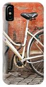 A Dejected Bicycle Waits Patiently On A Cobbled Street In Rome. IPhone Case