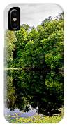 A Reflected Forest On A Lake With Lily Pads IPhone Case