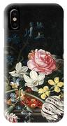 An Overturned Vase Of Flowers Resting On A Ledge IPhone Case