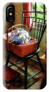 Basket Of Cloth And Yarn On Chair IPhone Case