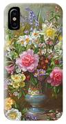 Bluebells Daffodils Primroses And Peonies In A Blue Vase IPhone Case