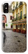 Cobblestone Argote De Molina Street With Cafe Ending At The Nort IPhone Case