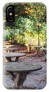 Empty Picnic Tables In The Early Fall With Fallen Leaves IPhone Case