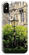 Lamppost In Front Of Green Bushes And Old Walls. IPhone Case