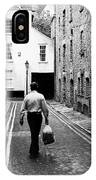 Man Walking With Shopping Bag Down Narrow English Street IPhone Case