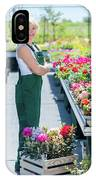 Professional Gardener At Work In A Nursery. IPhone Case