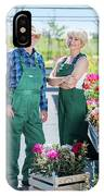 Senior Gardener And Middle-aged Gardener At Work. IPhone Case