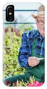 Senior Gardener Selecting A Tree. IPhone Case