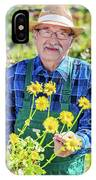 Senior Gardener Showing A Potted Flower. IPhone Case